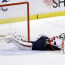Washington Capitals goalie Braden Holtby is unable to stop the game-winning goal by Florida Panthers center Nick Bjugstad in the shootout of an NHL hockey game, in Sunrise, Fla., Tuesday, Dec. 16, 2014 The Associated Press