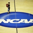 Mason Williams, 7, son of Marquette head coach Buzz Williams, helps collect basketballs during practice for a regional semifinal game in the NCAA college basketball tournament, Wednesday, March 27, 2013, in Washington. Marquette plays Miami on Thursday. (AP Photo/Pablo Martinez Monsivais)