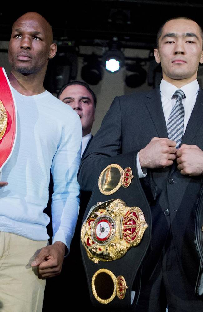 IBF light heavyweight boxing champion Bernard Hopkins, left, and WBA and IBA light heavyweight boxing champion Beibut Shumenov, right, of Kazakhstan, pose with their championship belts during a news conference in Washington, Thursday, April 17, 2014, about their 175-pound unification fight to be held at the DC Armory in Washington on April 19