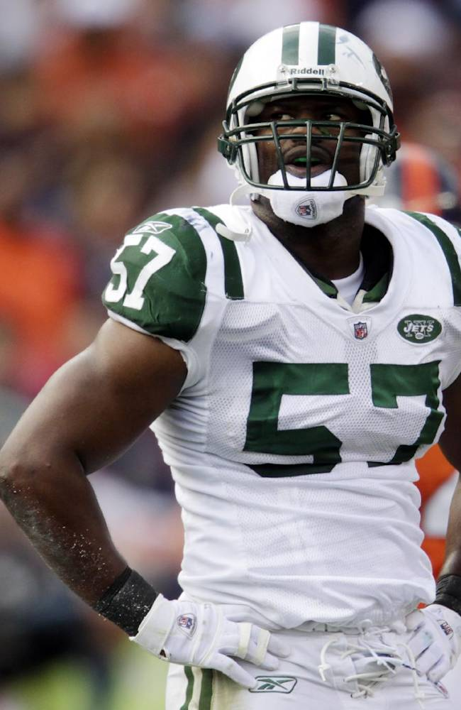In this Oct. 17, 2010, file photo, New York Jets linebacker Bart Scott looks on against the Denver Broncos during the second half of an NFL football game in Denver. Scott has made a seamless transition from the football field to the TV studio as one of the four hosts of CBS Sports Network's