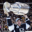 FILE - In this June 11, 2012, file photo, Los Angeles Kings defenseman Slava Voynov celebrates with the Stanley Cup after his team won the NHL hockey championship in Los Angeles. Voynov's attorney says Wednesday, Oct. 22, 2014, that Voynov never hit his girlfriend, and he blames his arrest on a misunderstanding partly caused by the couple's limited English. Craig Renetzky is hopeful the NHL will end Voynov's indefinite suspension after reviewing the events that led to Voynov's arrest at a hospital near his home. (AP Photo/Mark J. Terrill, File)