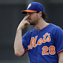 New York Mets infielder Daniel Murphy signals to a teammate during spring training baseball practice Saturday, Feb. 22, 2014, in Port St. Lucie, Fla The Associated Press