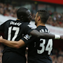 Hull City's Mohamed Diame, left celebrates with teammate Hatem Ben Arfa after scoring his side's first goal of the game during the English Premier League soccer match between Arsenal and Hull City at the Emirates stadium in London Saturday, Oct.18, 2014