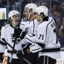 Los Angeles Kings' Jeff Carter, center, celebrates his goal with teammates Daniel Carcillo, left, and Jordan Nolan against the Toronto Maple Leafs during third period NHL hockey action in Toronto Wednesday, Dec. 11, 2013. (AP Photo/The Canadian Press, Mark Blinch)