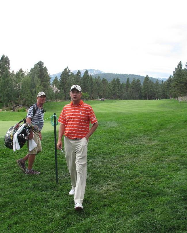 Davis Love III walks off the green at the 616-yard, par-5 18th at Montreux Golf & Country Club in Reno, Nev., Wednesday, July 30, 2014, during the pro-am for the PGA Barracuda Championship golf tournament, formerly known as the Reno-Tahoe Open