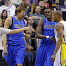 Referee Eric Dalen, left, and Dallas Mavericks center Samuel Dalembert, center right, separate Mavericks forward Dirk Nowitzki, left center, and Indiana Pacers forward David West after they exchanged words after a hard hit in the first half of an NBA bask