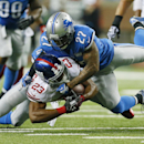 New York Giants running back Rashad Jennings (23) is stopped by Detroit Lions strong safety Glover Quin (27) during the second quarter of an NFL football game against the in Detroit, Monday, Sept. 8, 2014 The Associated Press