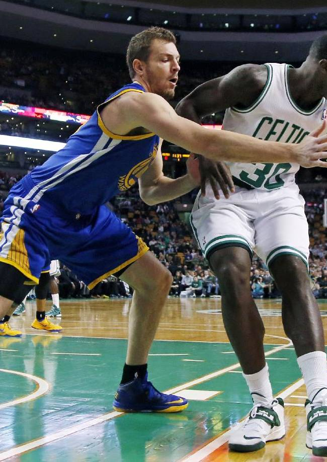 Golden State Warriors forward David Lee (10) reaches to defend against Boston Celtics power forward Brandon Bass (30) in the first half of an NBA basketball game in Boston, Wednesday, March 5, 2014