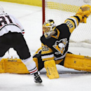 Pittsburgh Penguins goalie Marc-Andre Fleury (29) makes a save on a shot by Chicago Blackhawks' Marian Hossa (81) during the third period of an NHL hockey game in Pittsburgh Wednesday, Jan. 21, 2015. The Blackhawks won in a shootout 3-2 The Associated Pre