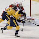 Nashville Predators center Mike Fisher (12) scores a goal past Carolina Hurricanes goalie Cam Ward (30) tying the game in the third period of an NHL hockey game Tuesday, Jan. 6, 2015, in Nashville, Tenn The Associated Press