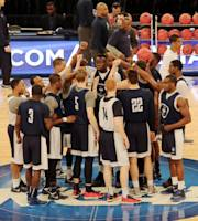 Connecticut players gather on the court at Madison Square Garden during practice at the NCAA college basketball tournament in New York, Thursday, March 27, 2014. Connecticut plays Iowa State in a regional semifinal on Friday. (AP Photo/Peter Morgan)