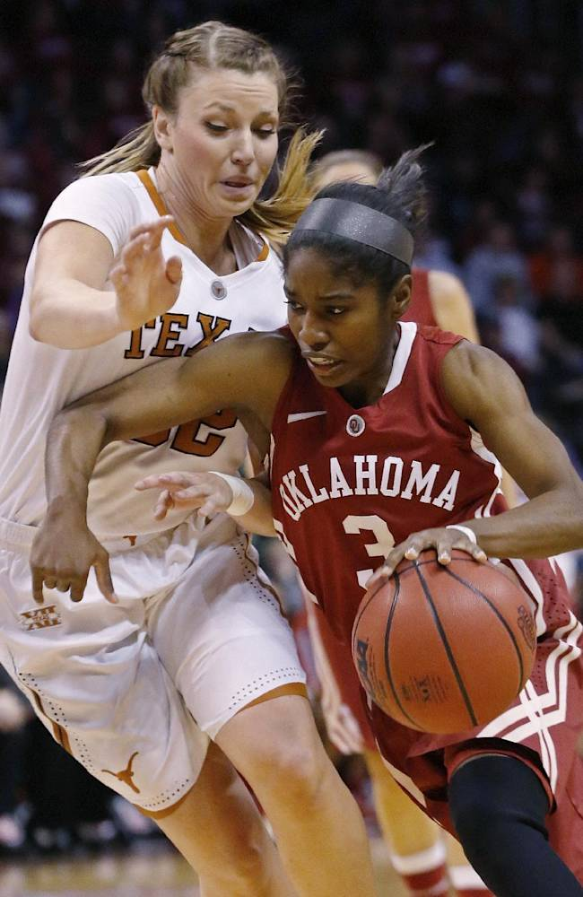 Oklahoma guard Aaryn Ellenberg (3) drives around Texas guard Brady Sanders (32) during the first half of an NCAA college basketball game in the quarterfinals of the Big 12 Conference women's tournament in Oklahoma City, Saturday, March 8, 2014. Texas won 82-72