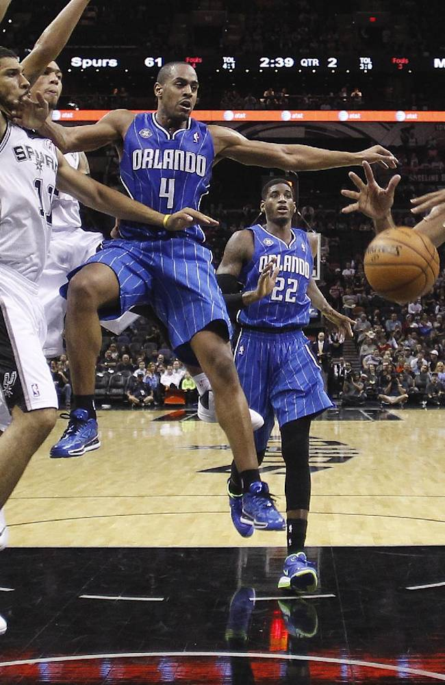 Orlando Magic's Arron Afflalo (4) is stripped of the ball by San Antonio Spurs' Jeff Ayres (11) as Tim Duncan (21) grabs the loose ball during the first half of a preseason NBA basketball game, Tuesday, Oct. 22, 2013, in San Antonio