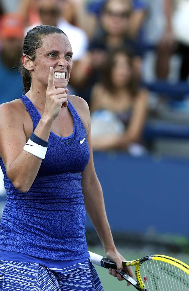 Roberta Vinci, of Italy, reacts after defeating Paula Ormaechea, of Argentina, 6-3, 6-3 during the opening round of the U.S. Open tennis tournament Monday, Aug. 25, 2014, in New York