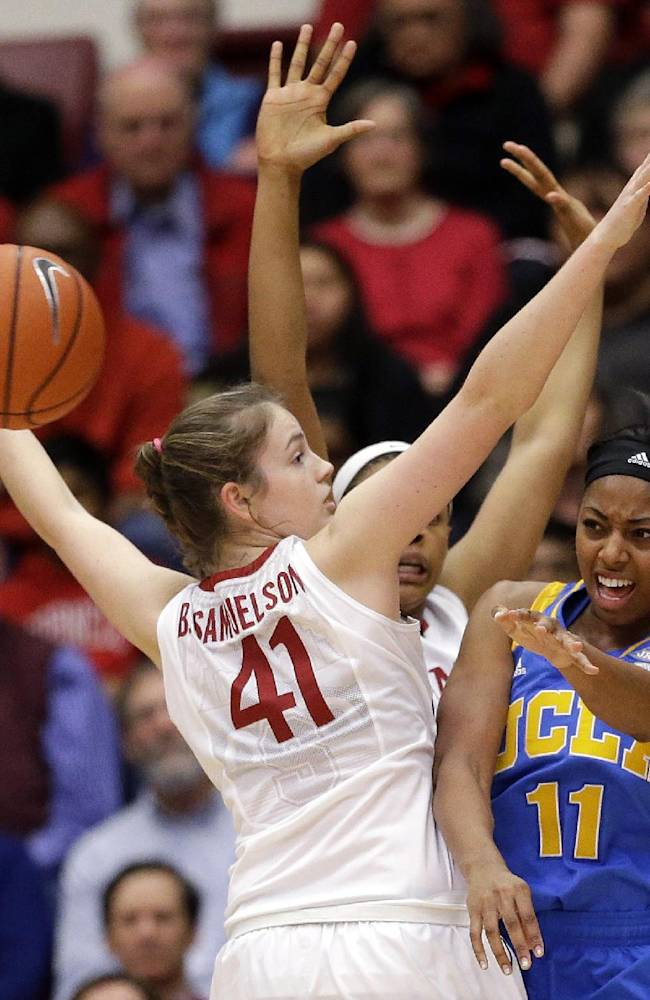 UCLA's Atonye Nyingifa (11) passes while Stanford's Bonnie Samuelson (41) defends during the first half of an NCAA college basketball game Friday, Jan. 24, 2014, in Stanford, Calif