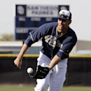 San Diego Padres' Tyson Ross fields a ground ball during spring training baseball practice Sunday, Feb. 16, 2014, in Peoria, Ariz The Associated Press