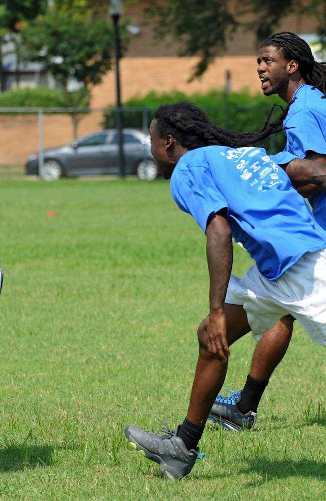 Buffalo Bills cornerback Mario Butler, back right, gives instructions as he chases a play during a passing drill at the inaugural Mario Butler Football FUNdamentals Camp, Saturday, June 21, 2014, in Jacksonville, Fla. Butler and his foundation teamed up with USA Football, a program of NFL Play 60, and other sponsors for the camp