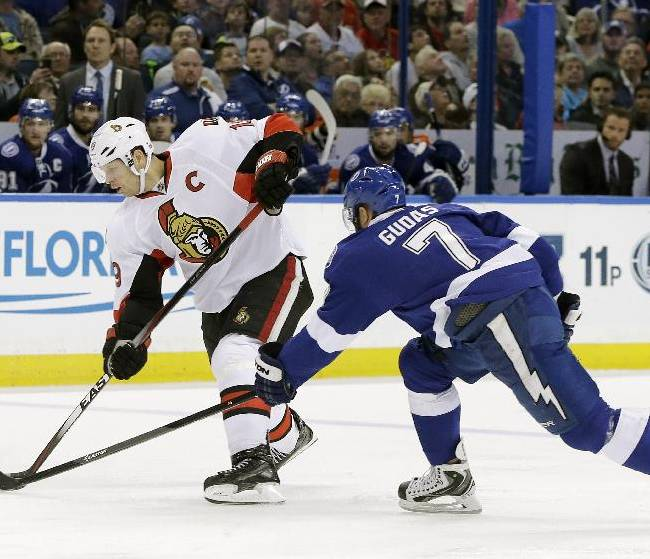 Ottawa Senators center Jason Spezza (19) gets off a shot after stealing the puck from Tampa Bay Lightning defenseman Radko Gudas (7), of the Czech Republic, during the first period of an NHL hockey game Monday, March 24, 2014, in Tampa, Fla