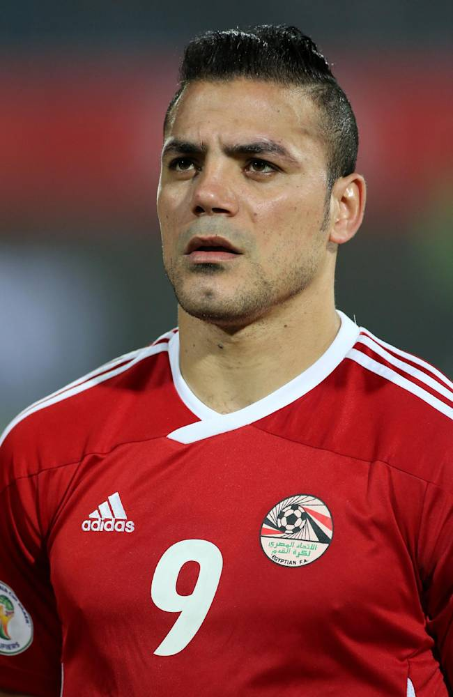 Egypt's forward Amr Zaki stands on the field during the World Cup qualifying playoff second leg soccer match, at the Air Defense Stadium in Cairo, Egypt, Tuesday, Nov. 19, 2013