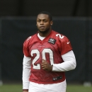 In this July 26, 2014, file photo, Arizona Cardinals' Jonathan Dwyer runs on the field during the first day of NFL football training camp in Glendale, Ariz. Dwyer is scheduled to be arraigned Monday, Oct. 6, 2014, in Phoenix, on charges that he assaulted
