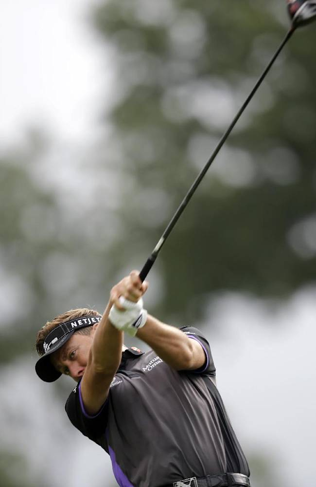 Ian Poulter, of England, hits a tee shot on the 16th hole during the second round of play at The Barclays golf tournament Friday, Aug. 22, 2014, in Paramus, N.J
