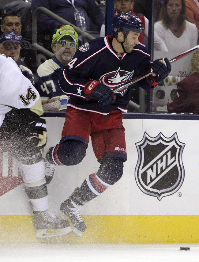 Columbus Blue Jackets' Derek MacKenzie, right, checks Pittsburgh Penguins' Chris Kunitz away from the puck during the second period of a first-round NHL playoff hockey game Monday, April 21, 2014, in Columbus, Ohio