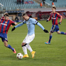 Manchester City's Aleksander Kolarov, center, vies for the ball with CSKA's Vasili Berezutski, left, during the Champions League Group E soccer match between CSKA Moscow and Manchester City at Arena Khimki stadium in Moscow, Russia, Tuesday Oct. 21, 2014