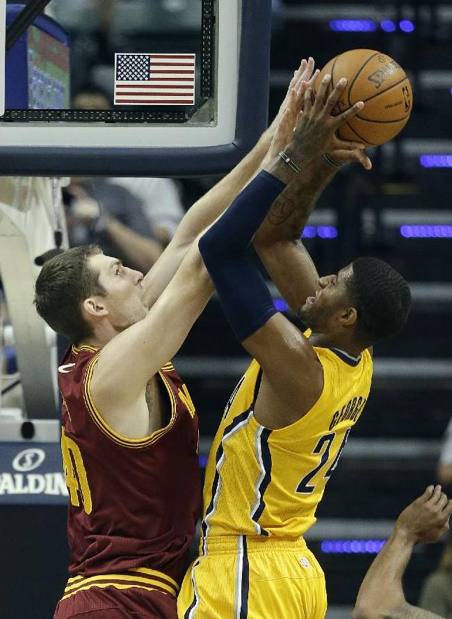 Indiana Pacers' Paul George, right, puts up a shot against Cleveland Cavaliers' Tyler Zeller during the first half of an NBA basketball game Saturday, Nov. 2, 2013, in Indianapolis