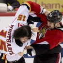 Ottawa Senators Matt Kassian, right, fights with Calgary Flames Kevin Westgarth during second period NHL action Sunday March 30, 2014 in Ottawa, Ontario The Associated Press