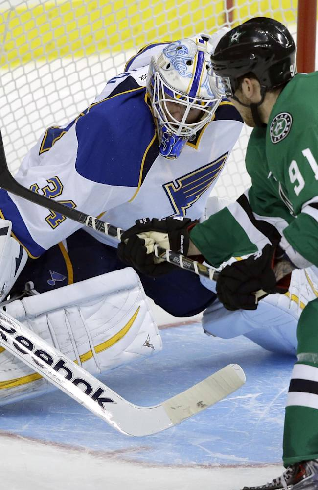 Dallas Stars center Tyler Seguin (91) misses a shot against St. Louis Blues goalie Jake Allen (34) during the overtime shootout in the NHL pre-season hockey game Sunday, Sept. 15, 2013, in Dallas.  The Blue won 6-5