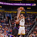 PHOENIX, AZ - MARCH 30: Paul George #24 of the Indiana Pacers shoots over P.J. Tucker #17 of the Phoenix Suns on March 30, 2013 at U.S. Airways Center in Phoenix, Arizona. (Photo by Barry Gossage/NBAE via Getty Images)