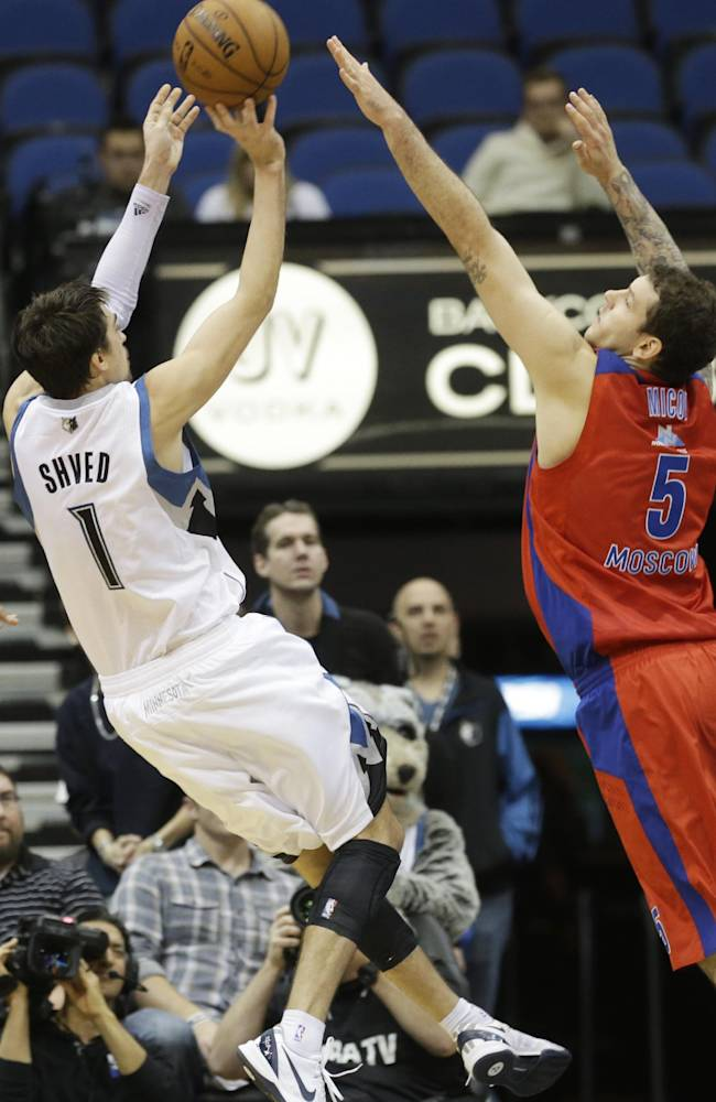 CSKA Moscow's Vladimir Micov, right, defends as Minnesota Timberwolves' Alexey Shved, left, misses a last-second shot in overtime of an exhibition NBA basketball game, Monday, Oct. 7, 2013, in Minneapolis, which CSKA won 108-106