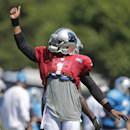 Carolina Panthers' Cam Newton reacts after completing a long pass during an NFL football practice at their training camp in Spartanburg, S.C., Monday, July 28, 2014 The Associated Press