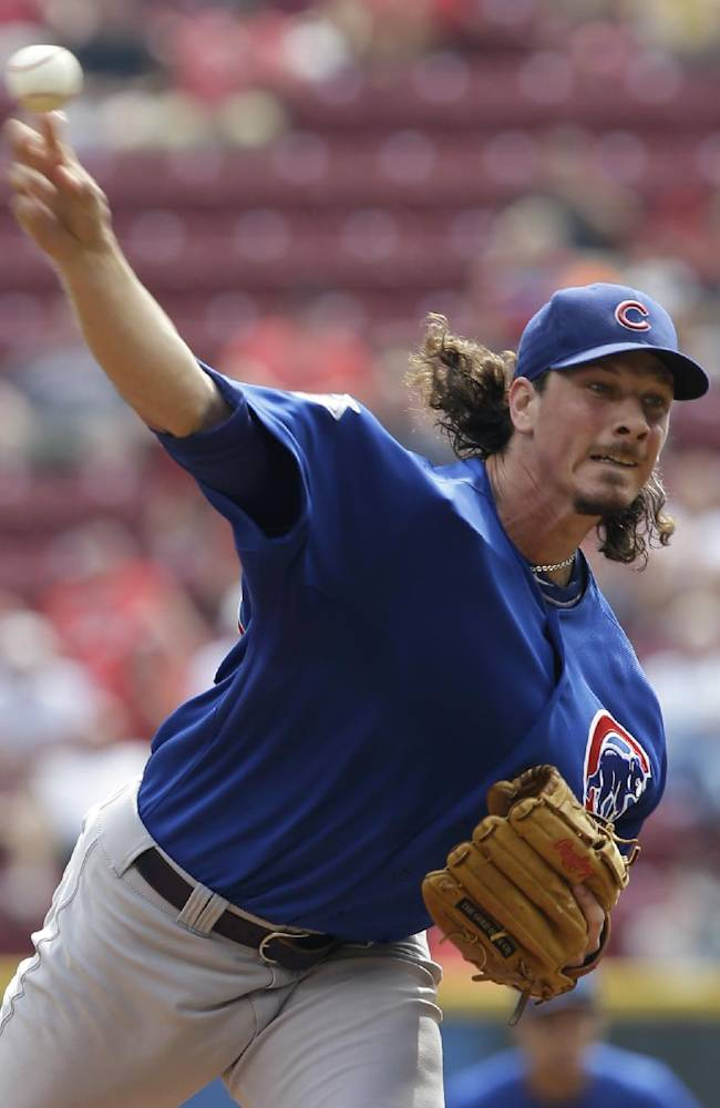 Chicago Cubs starting pitcher Jeff Samardzija throws against the Cincinnati Reds in the first inning of a baseball game, Wednesday, Sept. 11, 2013, in Cincinnati