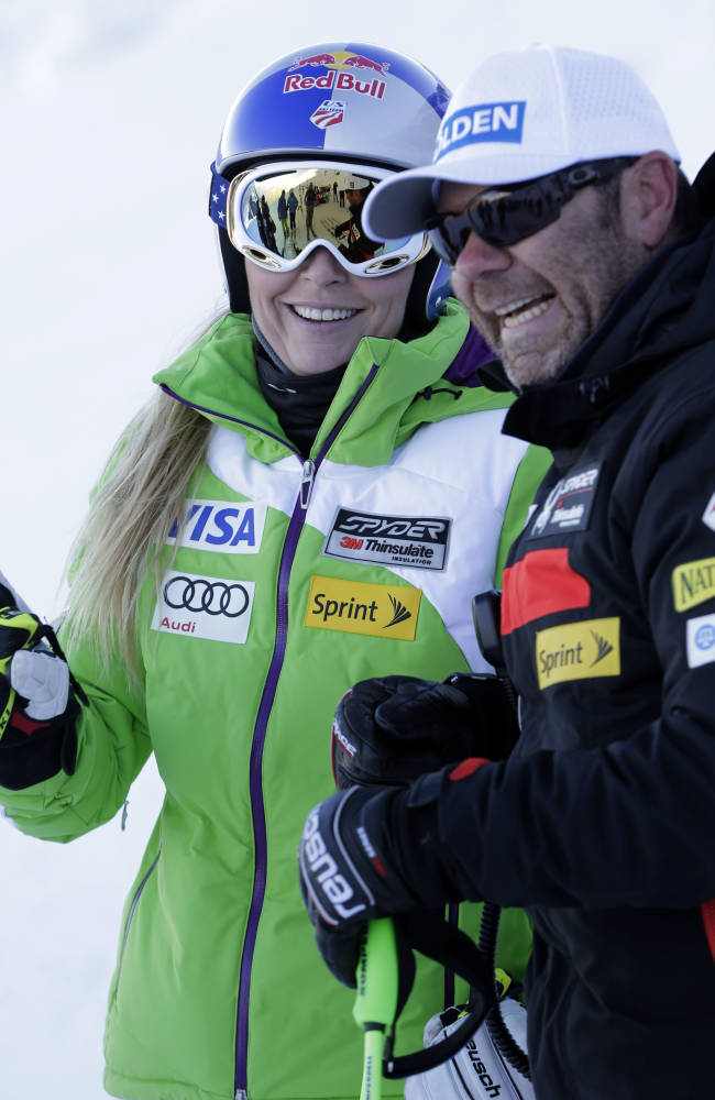 Ski racer Lindsey Vonn of the U.S., left, talks with an unidentified coach at the Rettenbach glacier in Soelden, Austria, Saturday, Oct. 4, 2014. Vonn started her first training after her knee injury