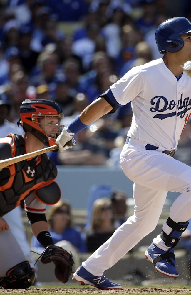 Los Angeles Dodgers' Andre Ethier, right, hits an RBI-single during the fifth inning of a baseball game against the San Francisco Giants, Friday, April 4, 2014, in Los Angeles