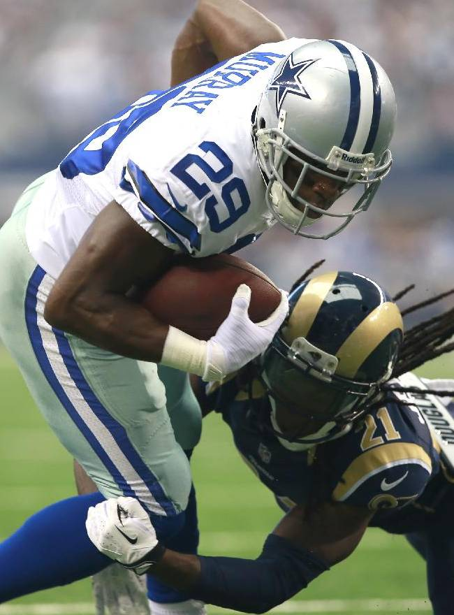 Dallas Cowboys running back DeMarco Murray (29) is tackled by St. Louis Rams cornerback Janoris Jenkins (21) during the first half of an NFL football game Sunday, Sept. 22, 2013, in Arlington, Texas
