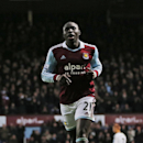 West Ham United s Mohamed Diame runs to celebrate after he scored against Fulham during their English Premier League soccer match in London, Saturday, Nov. 30, 2013