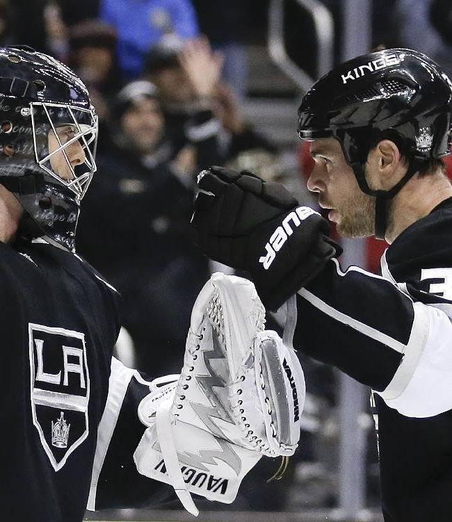 Los Angeles Kings goalie Ben Scrivens, left, and Tyler Toffoli celebrate their win against the St. Louis Blues during an NHL hockey game in Los Angeles, Monday, Dec. 2, 2013