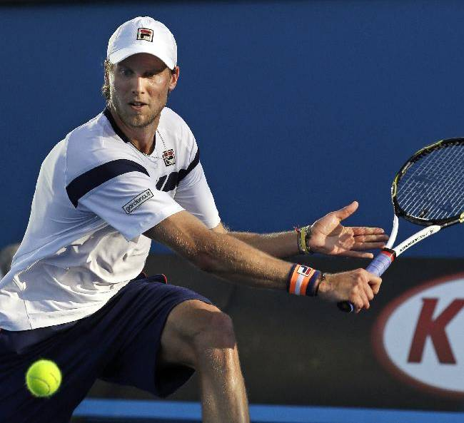 Andreas  Seppi of Italy makes a backhand return to Jeremy Chardy of France during their second round match at the Australian Open tennis championship in Melbourne, Australia, Wednesday, Jan. 21, 2015