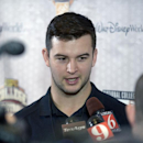 Alabama quarterback AJ McCarron answers questions during a media availability prior to the College Football Awards show in Lake Buena Vista, Fla., Wednesday, Dec. 11, 2013. (AP Photo/Phelan M. Ebenhack)