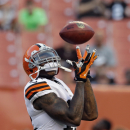 Cleveland Browns wide receiver Josh Gordon makes a catch during warmups before a preseason NFL football game against the St. Louis Rams Saturday, Aug. 23, 2014, in Cleveland. (AP Photo/Tony Dejak)