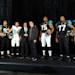Jacksonville Jaguars players (left to right) Paul Posluszny, Tyson Alualu, Cecil Shorts, Eugene Monroe, Uche Nwaneri and Marcedes Lewis model variants of the Jacksonville Jaguars new uniforms as they pose with team owner Shad Khan and Todd Van Horne, the VP, Creative Director for Football/Baseball Design for Nike during their reveal.   The Jacksonville Jaguars previewed the team's new Nike designed uniforms Tuesday afternoon in the West Touchdown  Club at EverBank Field, April 23, 2013.  (AP Photo/The Florida Times-Union, Bob Self)