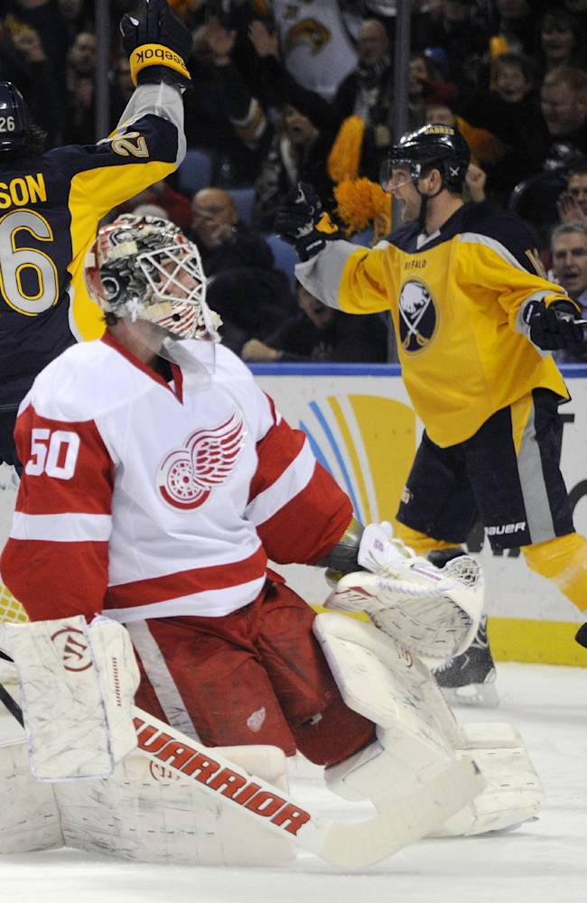 Buffalo Sabres' Matt Moulson, left,  celebrates a goal by Cody Hodgson, right, as Detroit Red Wings' goalie  Jonas Gustavsson, center, of Sweden, reacts during the first period of an NHL hockey game in Buffalo, N.Y., Sunday, Nov. 24, 2013