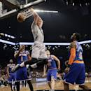 Brooklyn Nets' Mason Plumlee (1) dunks in front of New York Knicks' Tim Hardaway Jr. (5) during the first half of an NBA basketball game Tuesday, April 15, 2014, in New York. (AP Photo/Frank Franklin II)