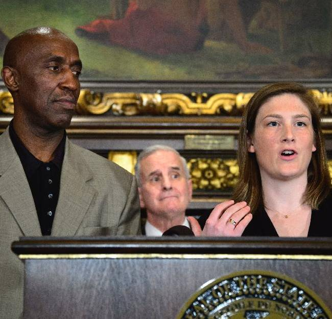Lindsay Whalen, right, Trent Tucker, both former Minnesota college basketball standouts, with Gov. Mark Dayton, center, hold a news conference at the state Capitol, Tuesday, June 3, 2014, in St. Paul, Minn. The two are honorary co-chairs in the bid to bring the NCAA's men's Final Four to Minnesota in 2019 or 2020. Dayton, Minnesota business leaders and sports celebrities announced Minnesota's bid