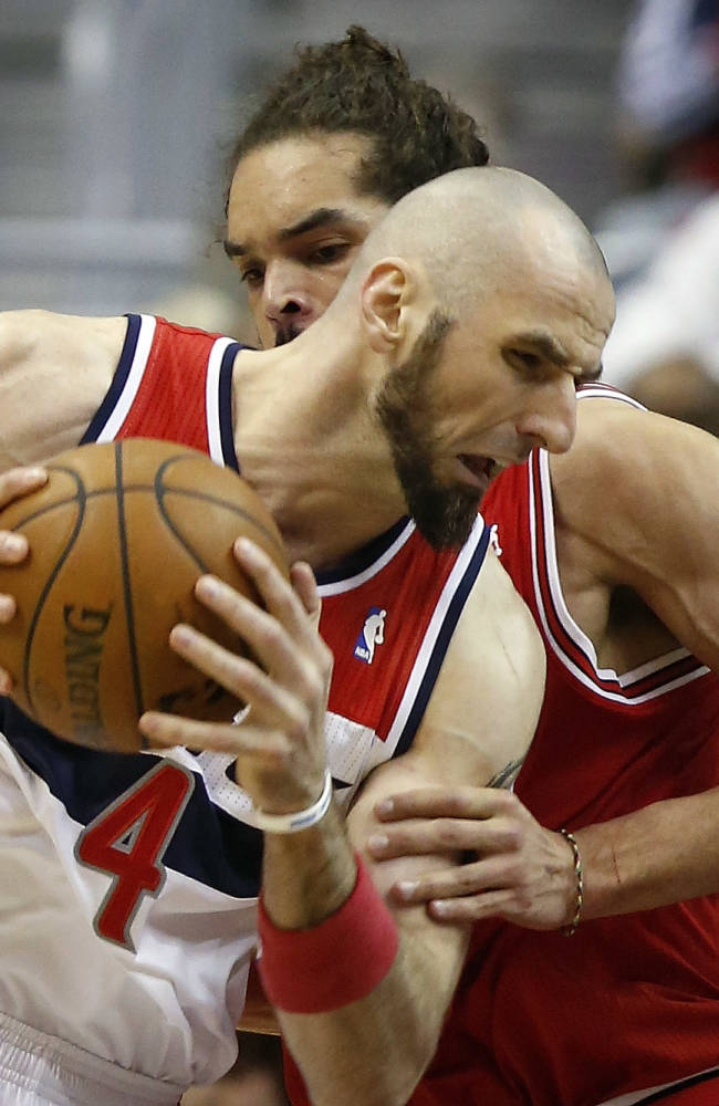 Washington Wizards center Marcin Gortat (4), from Poland, drives past Chicago Bulls center Joakim Noah during the first half of Game 4 of an opening-round NBA basketball playoff series in Washington, Sunday, April 27, 2014