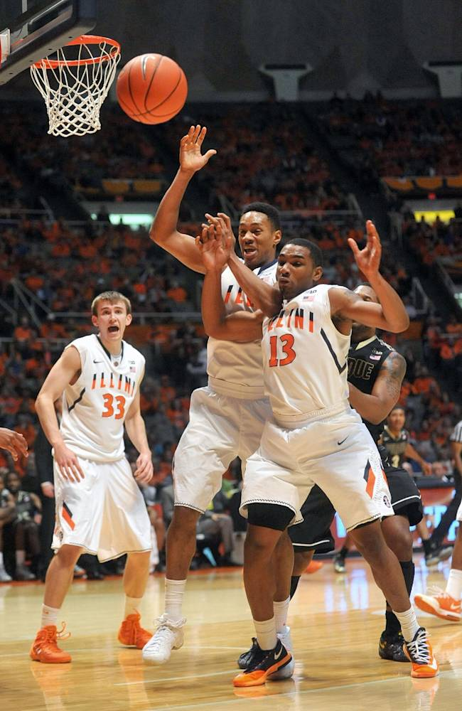 Illinois guard Joseph Bertrand (2) and Illinois guard Tracy Abrams (13) lose a ball out of bounds in the second half of an NCAA college basketball game Wednesday, Jan. 15, 2014, in Champaign, Ill