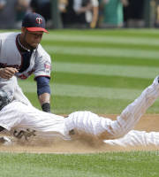 Chicago White Sox's Alexei Ramirez, bottom, slides safely into second base after hitting a double as Minnesota Twins shortstop Pedro Florimon applies a late tag during the first inning of a baseball game in Chicago, Saturday, Aug. 10, 2013. (AP Photo/Nam Y. Huh)