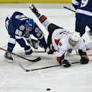 Tampa Bay Lightning's Matt Taormina (55) upends Ottawa Senators' Bobby Ryan (6) during the first period of an NHL hockey game on Thursday, Dec. 5, 2013 in Tampa, Fla The Associated Press
